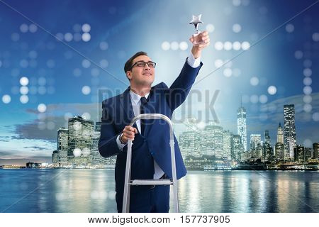 Businessman with star award in business concept