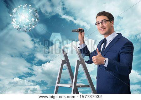 Businessman looking for dollars with binoculars