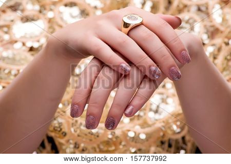 Woman showing off her jewellery rings in fashion concept