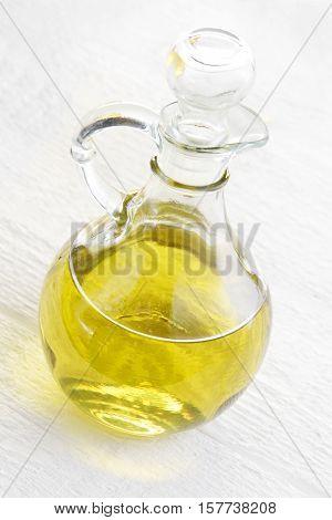 Glass bottle of vegetable oil on a white background