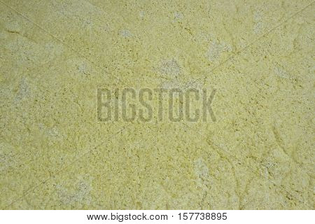 Close up of yellow corn mash in fermentation tank.
