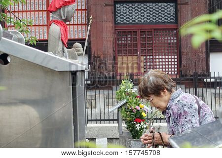 Kyoto May-31 2015 Old women respect belief by beautiful mind with Buddha image within Toji temple Kyoto Japan. Selective focus at wowen.