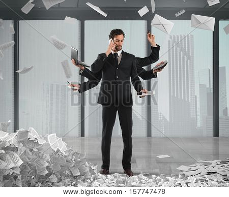 Businessman that to solve problems become multitasking with documents of bureaucracy and paperwork on background