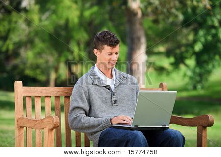Concentrated man working on his laptop