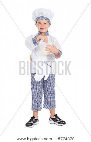 little girl in baker's uniform mixing flour, isolated on white