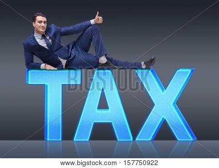 Businessman in tax burden business concept
