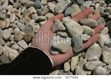 Handful Of Stones Over The Beach