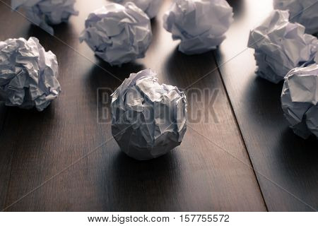 Crumpled Paper On Wood Background. Business Frustrations, Job Stress And Failed Exam Concept.