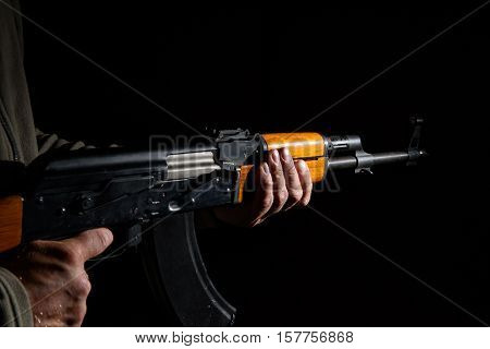 assault rifle close up in the dark