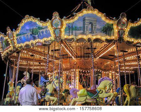 PARIS FRANCE - NOVEMBER 29 2006: Parisian colorful carousel by night