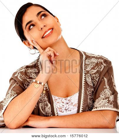 Pensive business woman looking up - isolated over white