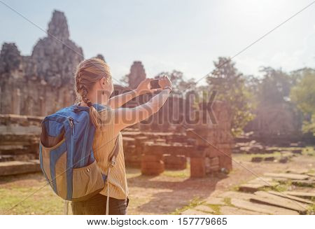 Female Tourist With Smartphone In Bayon Temple, Angkor Thom