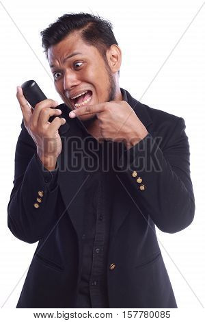 Men Showing His Expression Shouting Face While He Pointing His Finger At The Phone