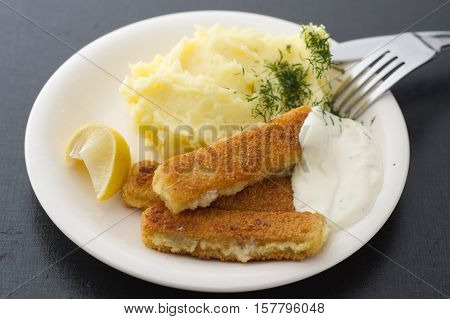 Fish fingers with homemade  mashed potatoes, dill and lemon
