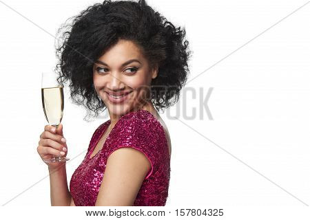 Party, drinks, holidays and celebration concept. Closeup happy smiling laughing mixed race woman in sequined dress with glass of champagne looking to the side at blank copy space