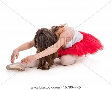 Young ballerina posing and dancing on a white background in studio