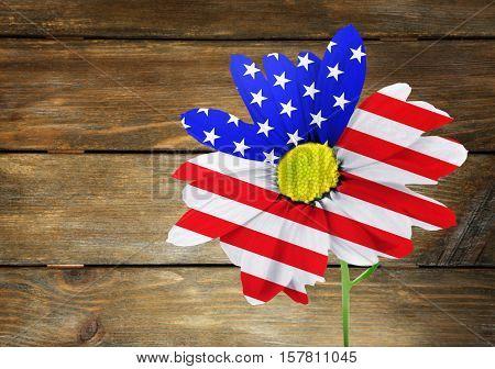 USA flag design of flower on wooden background