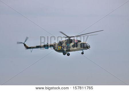 Vasilkov Ukraine - April 24 2012: Ukrainian Air Force Mi-8 medevac helicopter is landing in clear sky