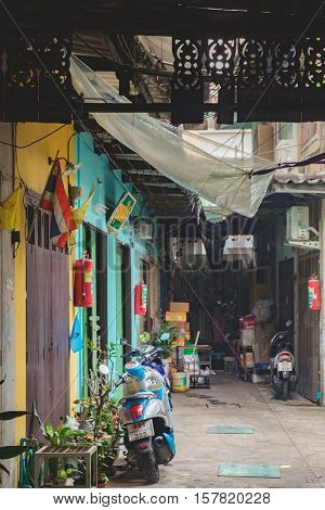 Bangkok, Thailand - January 8, 2016: Poor housing with personal transport at the door in Bangkok Thailand. View of a deserted alleyway