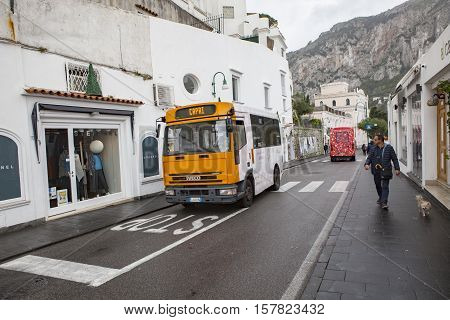 CAPRI ISLAND SOUTH ITALY - NOVEMBER 6 : capri island passenger bus running between capri port to top of island view point by narrow mountain street on november 6 2016 in naple habor italy