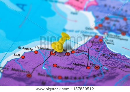 Casablanca in Morocco pinned on colorful political map of Africa. Geopolitical school atlas. Tilt shift effect.