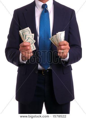 Businessman In Suit Holding Money