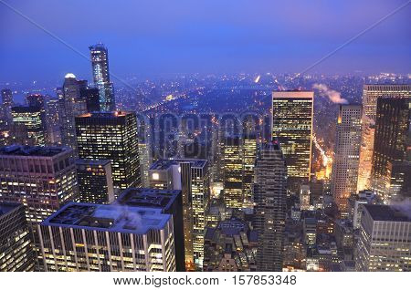 Manhattan Skyline and Central Park, viewed from Rockefeller Plaza at night, New York City, USA