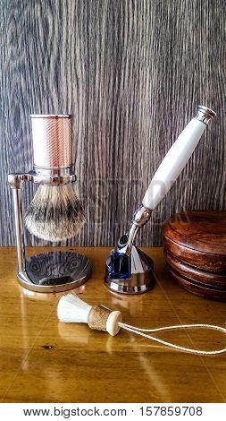 Luxury men's shaving accessories on wooden background