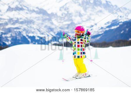 Ski And Snow Fun. Child In Winter Mountains.