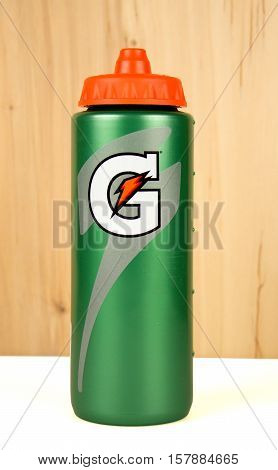 RIVER FALLS,WISCONSIN-NOVEMBER 22,2016: A plastic Gatorade brand hydration bottle with wood background.