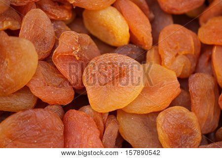 Heap of very dried apricots background. Dry fruit.