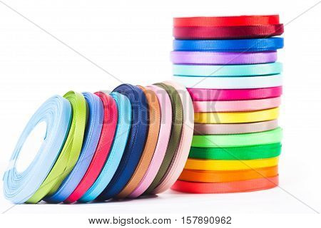 Various colors ribbon bobbins isolated on white