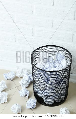 Office trashcan with the crumpled paper balls