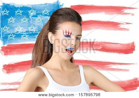 Young woman with creative makeup on USA flag background