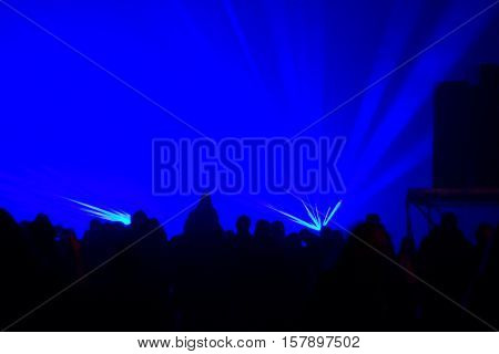 People is dancing in the party blue background