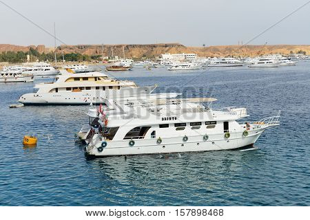 SHARM EL SHEIKH EGYPT - DECEMBER 4: The sail yachts with tourists are in harbor of Sharm el Sheikh. It is popular tourists destination on December 4 2013 in Sharm el Sheikh Egypt