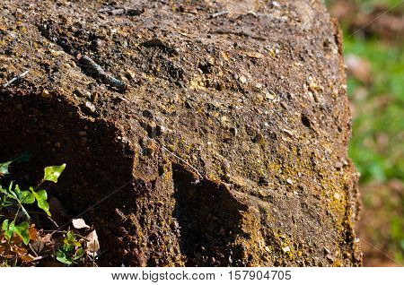 Large rough rock bolder outdoors in nature.