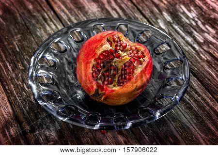 Juicy Pomegranates On Wooden Background