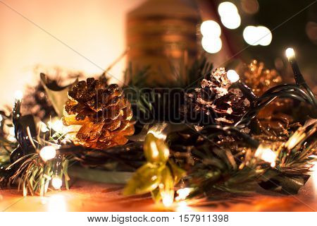 Candle with little lights and a pinecone.Decorative christmas composition. Suitable for Christmas or Xmas season and ideas.