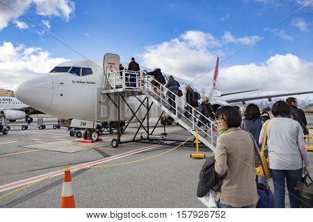 QUEENSTOWN NEW ZEALAND - SEPTEMBER 6: passenger preparing to flight by qantas airline to sydney at queenstown airport on september 6 2015 in Queenstown New Zealand