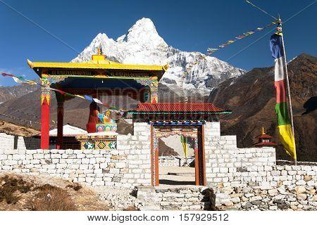 New statue of buddha in Pangboche monastery and mount Ama Dablam Khumbu valley near Tengboche way to Everest base camp Nepal