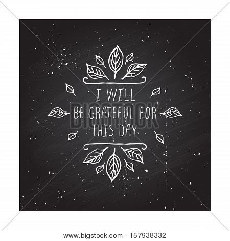 Handdrawn thanksgiving label with leaves and text on chalkboard background. I will be grateful for this day.