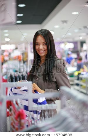 Beautiful girl shopping in a department store. Shallow DOF.