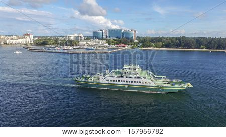 Labuan,Malaysia-Nov 23,2016:Ferryboat passenger sailing to Menumbok,Sabah on 23rd Nov 2016 with background of Labuan island.There is a daily ferry service between Menumbok,Sabah and Labuan island.