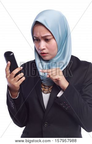 angry businesswomen while pointing her finger to the phone isolated on white background