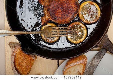 Pork Chop Seared On Iron Skillet