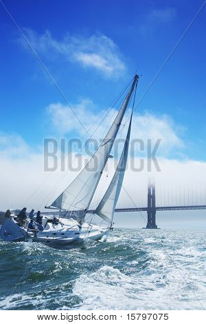 Beautiful yacht in San Francisco bay, Golden Gate bridge on the horizon. California, USA