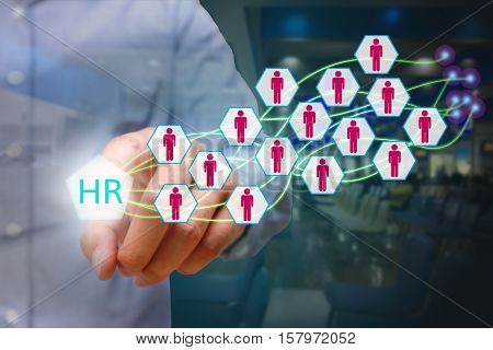 Human resources management concept business man pressing HR icon on virtual screen.