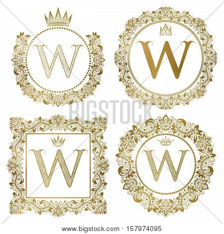 Golden letter W vintage monograms set. Heraldic coats of arms round and square frames.