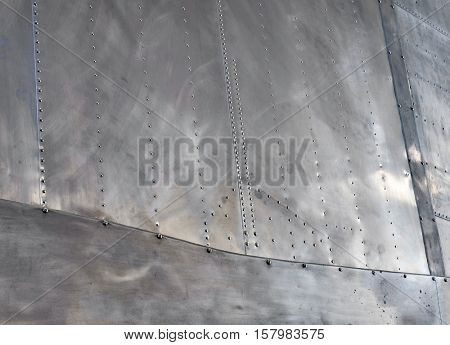 DAYTON, OHIO, USA - NOVEMBER 18, 2016: National Museum USAF is restoring the famous original WWII Memphis Belle B-17F Flying Fortress bomber, shown here is a close-up of riveted fuselage.